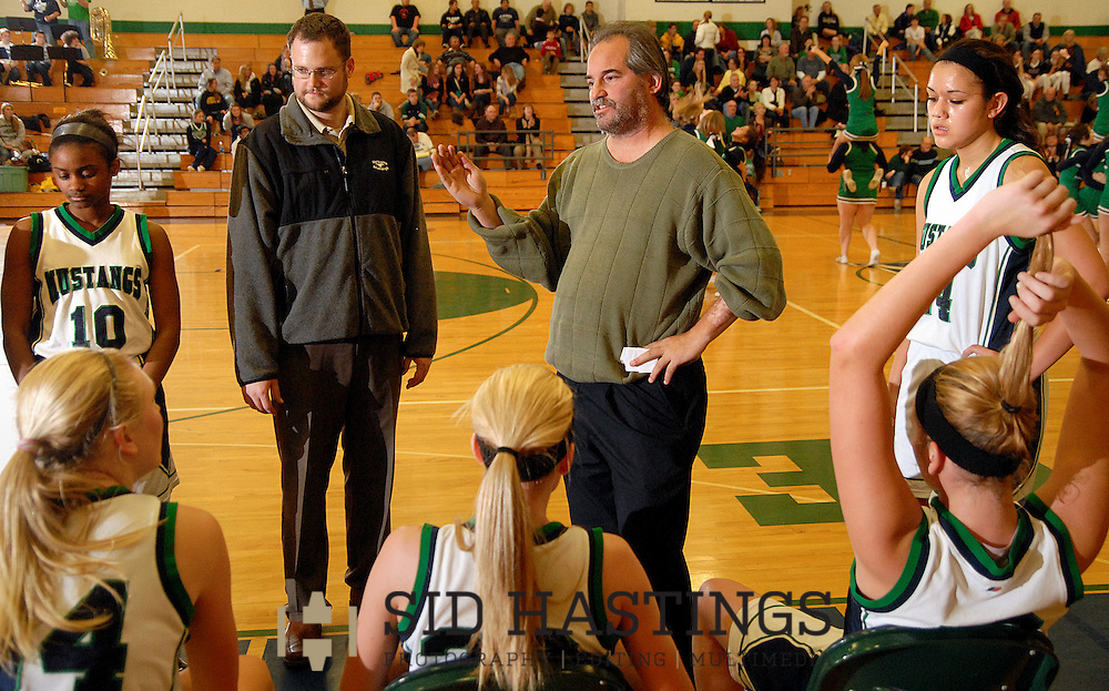 22 DEC. 2010 -- CHESTERFIELD, Mo. -- Marquette High School girls' basketball coach Scott Cleer (center) talks with his team during a time out in the third quarter of the Mustangs' game with Eureka High School at Marquette Wednesday, Dec. 22, 2010. Eureka won 63-49. Image copyright (c) 2010 by Sid Hastings.