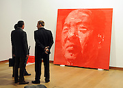 London News pictures. 08.02.2011. A group of men in suits stand in front of a portrait of Moa by Yan Pei-Ming entitled Grand Timonier. A preview, today (Fri) of Christie's Auction House Post-War and Contemporary Art Evening Auction. The sale is expected to make a combined total of 46,246,000 to 66,447,000 when it is sold on 16th Feb 2011.. Picture Credit should read Stephen Simpson/LNP