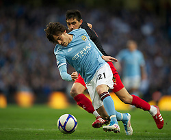 MANCHESTER, ENGLAND - Sunday, March 13, 2011: Manchester City's David Silva in action against Reading during the FA Cup 6th Round match at the City of Manchester Stadium. (Photo by David Rawcliffe/Propaganda)