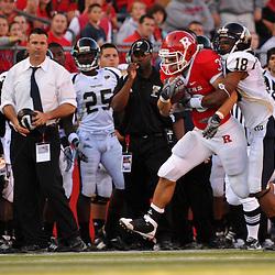 Sep 19, 2009; Piscataway, NJ, USA; Rutgers running back Joe Martinek (38) drags Florida International cornerback Kreg Brown (18) during the first half of NCAA college football between Rutgers and Florida International at Rutgers Stadium.