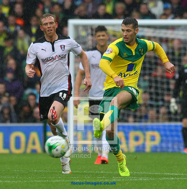 Wes Hoolahan of Norwich and Paul Green of Rotherham United in action during the Sky Bet Championship match at Carrow Road, Norwich<br /> Picture by Paul Chesterton/Focus Images Ltd +44 7904 640267<br /> 04/10/2014
