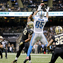 Dec 21, 2015; New Orleans, LA, USA; Detroit Lions tight end Eric Ebron (85) catches a pass over New Orleans Saints middle linebacker Stephone Anthony (50) and strong safety Kenny Vaccaro (32) during the second half of a game at the Mercedes-Benz Superdome. The Lions defeated the Saints 35-27. Mandatory Credit: Derick E. Hingle-USA TODAY Sports