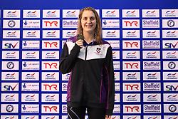 The medal ceremony for the Women's 200m Butterfly, gold medalist Charlotte Atkinson during day three of the 2017 British Swimming Championships at Ponds Forge, Sheffield.
