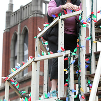 Carol Samarov checks the lights on the Singing Christmas Tree frame at First United Methodist Church on Thursday afternoon in Tupelo.