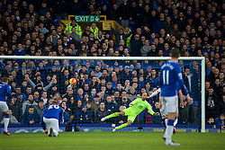 LIVERPOOL, ENGLAND - Sunday, January 24, 2016: Everton's goalkeeper Tim Howard is sent the wrong way as Swansea City's Gylfi Sigurosson scores the first goal from a penalty kick during the Premier League match at Goodison Park. (Pic by David Rawcliffe/Propaganda)