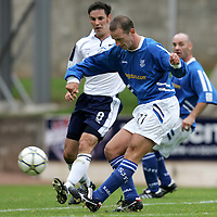 St Johnstone v Ross County..10.09.05 <br />Paul Sheerin chips the ball only to see it clear Stewart Garden and hit the cross bar<br /><br />Picture by Graeme Hart.<br />Copyright Perthshire Picture Agency<br />Tel: 01738 623350  Mobile: 07990 594431