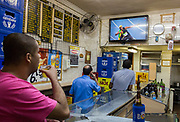 epa05485950 Brazilians react to live television coverage in a bar of Usain Bolt of Jamaica winning the men's 100m Final of the Rio 2016 Olympic Games Athletics, Track and Field events at the Olympic Stadium in Rio de Janeiro, Brazil, 14 August 2016.  EPA/NIC BOTHMA