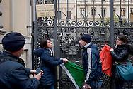 Roma  3 Febbraio 2014<br /> Flash mob presso l'ambasciata dell India dopo l'ennesimo rinvio della corte suprema indiana sui marò  Salvatore Girone e Massimiliano Latorre,con il Vicepresidente del Parlamento europeo Roberta Angelilli.e  i giovani del Nuovo Centrodestra.I manifestanti  mettono  la bandiera italiana sul cancello dell'Ambasciata dell'India, La polizia allontana i manifestanti.<br /> Rome February 3, 2014 <br /> Flash Mob at the Embassy of India after yet another postponement of the Indian Supreme Court on marines Salvatore Girone and Massimiliano Latorre, with the Vice-President of the European Parliament Roberta Angelilli with  young of the New center-right . The protesters put the Italian flag on the gate of the Embassy of India.The police away the protesters