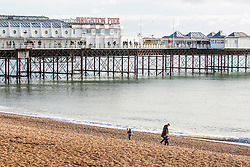 © Licensed to London News Pictures. 01/12/2019. Brighton, UK. Only a handful of people can be seen on the beach in Brighton and Hove as colder weather is hitting the seaside resort. Photo credit: Hugo Michiels/LNP