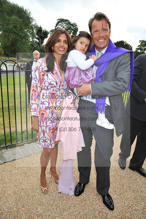 JOEL & DIVIA CADBURY and their daughter ARYANA at the unveiling of 'Isis' a sculpture by Simon Gudgeon hosted by the Royal Parks Foundation and the Halcyon Gallery by the banks of The Serpentine, Hyde Park, London on 7th September 2009.