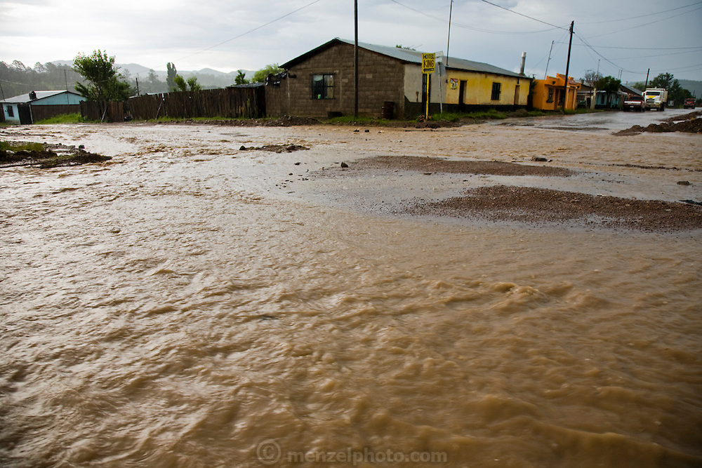 Streets are flooded with runoff water after a heavy afternoon summer downpour in the town of Yecora in the Sierra Mountains, near Maycoba, Sonora, Mexico.