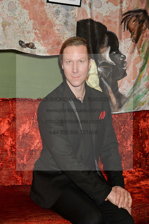 Artist MARC McGREEVY at a reception to launch an exclusive auction of hand-painted silk scarves by some of the UK's hottest designers in aid of Save The Children by Mary's Living & Giving shops, held at the May Fair Hotel, Stratton Street, London on 12th February 2014,