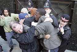 Michael Adebolajo (grey coat) during a muslim riot outside Old Bailey, London, UK,  November 01, 2006...Woolwich attacker arrested during violent protests by extremists at the Old Bailey. November 01, 2006 - Image filed 24 May 2013. Picture by: Will Wintercross / i-Images