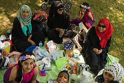 London, July 17th 2015. Muslims celebrate Eid with a picnic in Regents Park, after prayers at the adjacent Mosque.