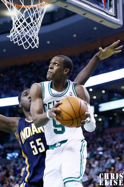 04 January 2013: Boston Celtics point guard Rajon Rondo (9) goes for the reverse layup past Indiana Pacers center Roy Hibbert (55) during the Boston Celtics 94-75 victory over the Indiana Pacers at the TD Garden, Boston, Massachusetts, USA.