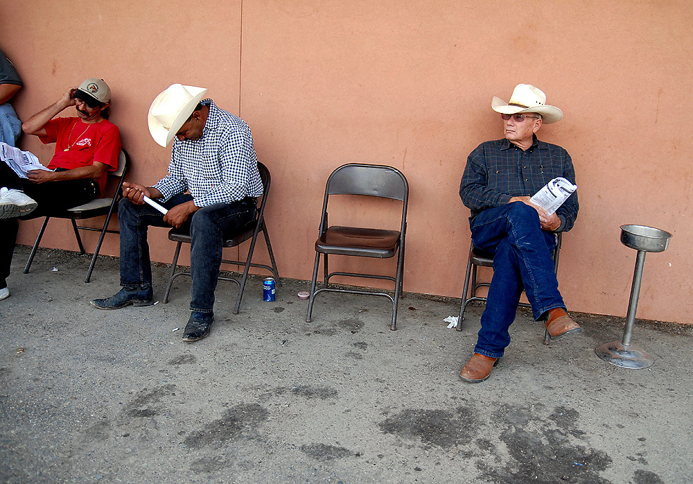 Thoroughbred horse racing fans relax before the start of the next race at Yavapai Downs in Prescott Valley, Arizona.