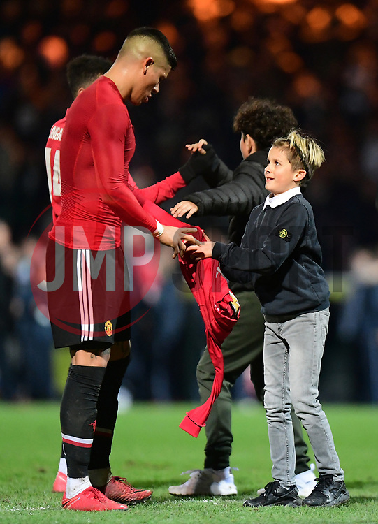 Marcos Rojo of Manchester United hands his shirt to a young fan at full time  - Mandatory by-line: Alex Davidson/JMP - 26/01/2018 - FOOTBALL - Huish Park - Yeovil, England -  v Manchester United - Emirates FA Cup fourth round proper