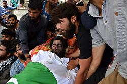 June 17, 2017 - Kulgam, Jammu and Kashmir, India - People offered funeral near the body of a slain Kashmiri Rebel ashkar-e-Taiba (LeT) commander JUNAID AH MATOO at Khudwani village of kulgam District, 60KM from Srinagar. Tawseef along with two associates killed in 20 hours long gun battle in Arwani Kulgam. (Credit Image: © Muneeb Ul Islam/Pacific Press via ZUMA Wire)