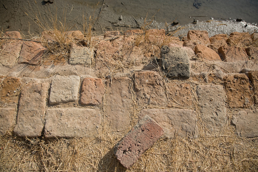 Detail of Harappan masonry at Lothal in a detailed view of a pavement showing for size contrast a single modern brick.
