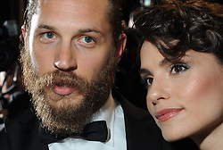 Actor Tom Hardy and girlfriend Rachel Speed leaving the red carpet premiere of Lawless at the Cannes Film Festival on Saturday, May 19th  2012 Photo Ki Price. Photo by: Ki Price / i-Images<br /> File Photo : Tom Hardy in talks to play both Kray Twins.<br /> Tom Hardy is rumoured to be in line to play the notorious Kray twins, Reginald and Ronald, in an upcoming biopic.<br /> Photo filed Tuesday 25th Feb 2014.