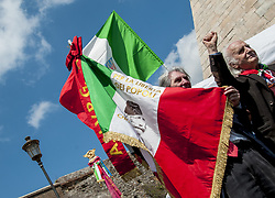 April 25, 2017 - Rome, Italy, Italy - Rome celebrated the recurrence of Liberation with a procession called by the Anpi (Association of Partisans of Italy) Many banners of the section Anpi - ''Partigiani'' was written on the banner that opened the event ''- and of the Palestinian communities and associations. A march came to Porta San Paolo, where the mayor of Virginia Raggi also intervened. A delegation of protesters then went to bring flowers to the tombstone on the Iron Bridge dedicated to the 10 women killed by the Nazis on April 7, 1944 for retaliation against the '' Assault on the oven for bread (Credit Image: © Patrizia Cortellessa/Pacific Press via ZUMA Wire)