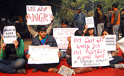 Indian display posters during a protest to mourn the death of a gang-rape victim in New Delhi, India, January 1, 2013. Photo by Imago / i-Images...UK ONLY