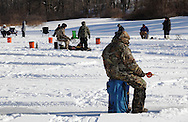 Middletown, New York - People fish on a frozen lake during the annual ice fishing contest at the Shawangunk Fish & Game Association on Jan. 23, 2011.