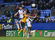 Bolton Wanderers Jason Lowe(left) jumps for the ball with Southend United defender Jason Demetriou during the EFL Sky Bet League 1 match between Bolton Wanderers and Southend United at the University of  Bolton Stadium, Bolton, England on 21 December 2019.