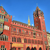 Rathaus Town Hall in Basel, Switzerland <br /> The centerpiece of Basel, Switzerland, is the Rathaus.  It was the site of the first Town Hall in the 14th century when citizens wanted independence from a ruling bishop.  This gorgeous, red sandstone government center with three pointed arcades was built in the early 16th century, decorated with frescos in the early 17th century, and the bell tower was added around 1900.  The Cantonal Government of Basel-Stadt still meet here every week and the Parliament assembles bi-monthly.
