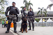 Three armed and armoured police officers and a large dog outside the Maracana stadium. A significantly increased police presence is in evidence around the Maracana stadium before the 2014 FIFA World Cup match at Maracana Stadium, Rio de Janeiro, Brazil. This follows the storming of the Stadium Media Centre by Chilean fans earlier in the week. <br /> Picture by Andrew Tobin/Focus Images Ltd +44 7710 761829<br /> 22/06/2014
