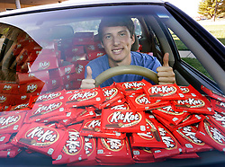IMAGE DISTRIBUTED FOR THE HERSHEY COMPANY - Hunter Jobbins, freshman at Kansas State University is all smiles in his car filled with nearly 6,500 Kit Kat bars on Thursday, Nov. 3, 2016, in Manhattan, Kansas. Earlier this week, Jobbins had a Kit Kat bar stolen from his unlocked car and a mysterious note was left from the thief. (Colin E. Braley/AP Images for The Hershey Company)