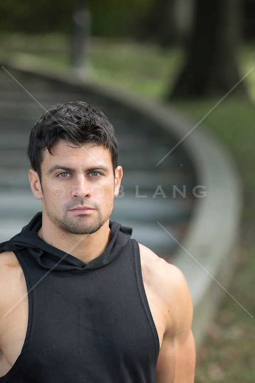 portrait of a handsome man with green eyes and dark hair outdoors