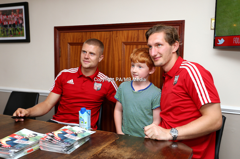 Brentford's Jake Bidwell (left) and Jack Bonham pose for photographs with fans during a family day at Griffin Park