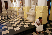 A pilgrim in prayer, Temple of the Tooth, Kandy.