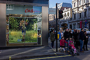 Shoppers wait to cross the road outside the Piccadilly branch of British fashion brand Cath Kidston on the corner of Duke Street, central London.