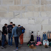 Groups of tourists snap photos of their feet on the Washington Monument during the kite festival on the National Mall as part of the National Cherry Blossom Festival. April, 02, 2016 in Washington, DC.