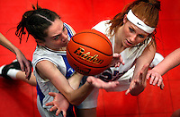 JEROME A. POLLOS/Press..Post Falls Christian's Katie Hoye, right, and Coeur d'Alene High School's Shandra Naegle go up for a rebound during their game Thursday. The Eagles beat the Vikings 47-16 to keep their undefeated record of 2-0 this season.