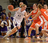 Kansas State center JoAnn Hamlin (L) drives against pressure from Idaho State's Natalie Doma (C) and Jeni Boesel (R) during the first half at Bramlage Coliseum in Manhattan, Kansas, March 17, 2006.  K-State defeated the Bengals 88-68 in the first round of the WNIT.
