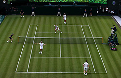 Lleyton Hewitt and Pat Cash play against Goran Ivanisevic and Jamie Murray on No.1 court at The All England Lawn Tennis Club, London.