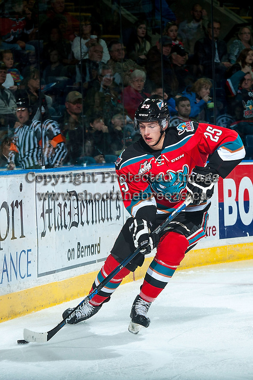 KELOWNA, CANADA - NOVEMBER 11: Cal Foote #25 of Kelowna Rockets skates with the puck behind the net against the Vancouver Giants on November 11, 2015 at Prospera Place in Kelowna, British Columbia, Canada.  (Photo by Marissa Baecker/ShoottheBreeze)  *** Local Caption *** Cal Foote;