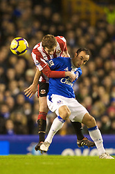 LIVERPOOL, ENGLAND - Wednesday, January 27, 2010: Everton's Landon Donovan and Sunderland's George McCartney during the Premiership match at Goodison Park. (Photo by: David Rawcliffe/Propaganda)