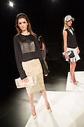 A skirt with beads and sequins paired with a two-tone black top with a jeweled collar. By Monika Chiang at Spring 2013 Fashion Week in New York.
