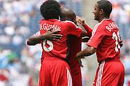 16 June 2007: Canada's Julian DeGuzman (6), Ali Gerba, and Patrice Bernier (15) celebrate a Canada goal in the 17th minute. The Canada Men's National team defeated the Guatemala Men's National Team 3-0 at Gillette Stadium in Foxboro, Massachusetts in a 2007 CONCACAF Gold Cup quarterfinal.