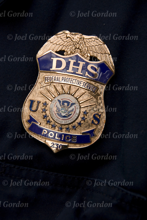 Close up of badge of Department of Homeland Security, Federal Protection Services, officer.