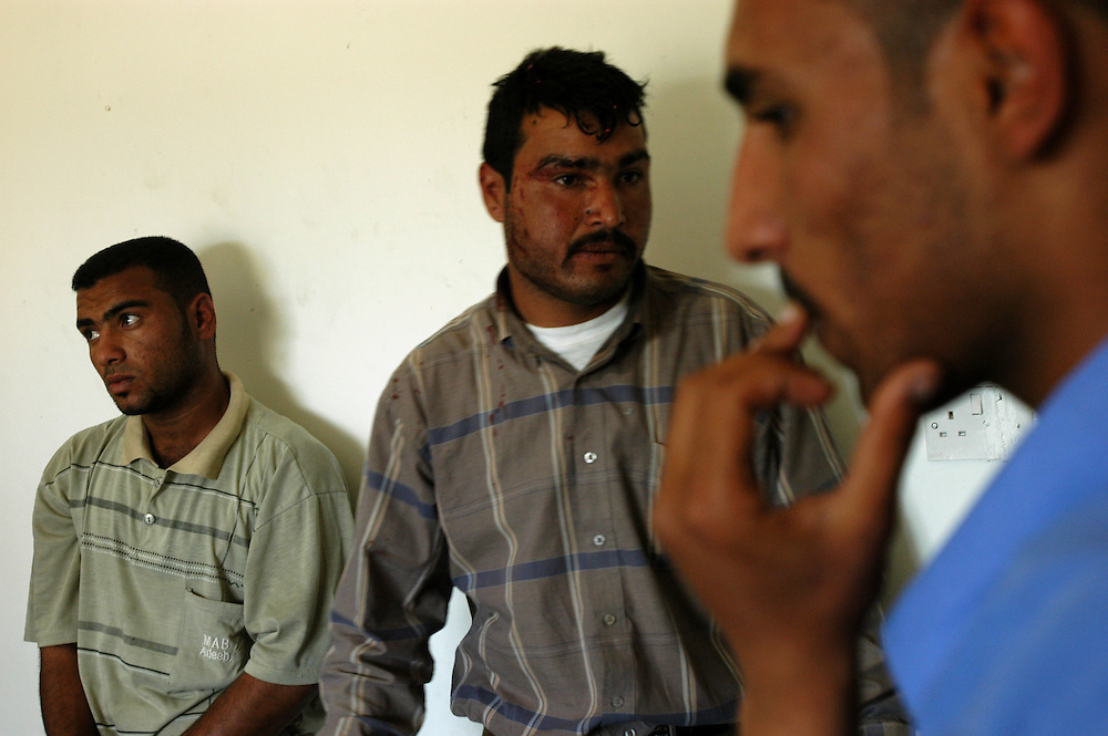 Men detained for attacking Iraqi Police at the al-Bahya police station..Baghdad, Iraq. 27/04/2004.Photo © J.B. Russell