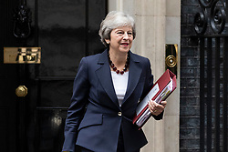 © Licensed to London News Pictures. 17/10/2018. London, UK. Prime Minister Theresa May leaves 10 Downing Street as she heads to Parliament for Prime Minister's Questions. Photo credit: Rob Pinney/LNP