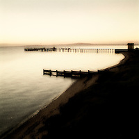 A long jetty on calm water