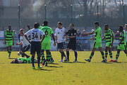 Guiseley's Jake Cassidy is sent off for an elbow on Forest Green Rovers Mark Ellis(5) during the Vanarama National League match between Guiseley  and Forest Green Rovers at Nethermoor Park, Guiseley, United Kingdom on 8 April 2017. Photo by Shane Healey.