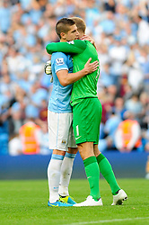 Manchester City's Joe Hart and Manchester City's Matija Nastasic congratulate each other after the game - Photo mandatory by-line: Dougie Allward/JMP - Tel: Mobile: 07966 386802 22/09/2013 - SPORT - FOOTBALL - City of Manchester Stadium - Manchester - Manchester City V Manchester United - Barclays Premier League