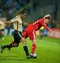 MARSEILLE, FRANCE - Tuesday, September 16, 2008: Liverpool's Fernando Torres in action against Olympique de Marseille's Vitorino Hilton during the opening UEFA Champions League Group D match at the Stade Velodrome. (Photo by David Rawcliffe/Propaganda)